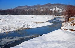 Transversing river in winter day Stock Photography