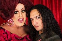 Transvestit med den manliga partnern Arkivfoto