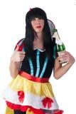 Transvestite as Sleeping Beauty with wine bottle Royalty Free Stock Image