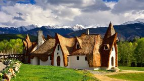 Transylvania clay castle in Romania, in the spring with mountains in the background
