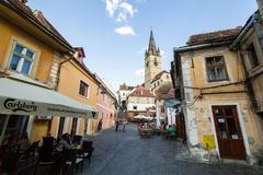 Sibiu - Romania, July 18, 2017: Transylvania. Lutheran Church, built in the Huet Square, seen from the streets of medieval Lower T. Transylvania. Lutheran Church Stock Photo