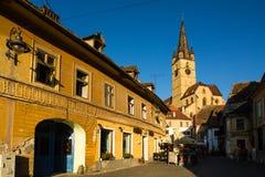 Sibiu - Romania, July 18, 2017: Transylvania. Lutheran Church, built in the Huet Square, seen from the streets of medieval Lower T. Transylvania. Lutheran Church Stock Photos