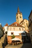 Sibiu - Romania, July 18, 2017: Transylvania. Lutheran Church, built in the Huet Square, seen from the streets of medieval Lower T. Transylvania. Lutheran Church Royalty Free Stock Images