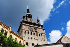 Transylvania, Sighisoara's Clock Tower. The Clock Tower in Sighisoara, Romania was built in the XIV century and has 64 meters high. It is a historical and Stock Images