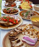 Transylvanian traditional food dish. Transylvanian traditional food buffet with different pork dishes and vegetables royalty free stock photos