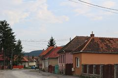 Transylvanian village. Houses and road in a Transylvanian village in Harghita county Royalty Free Stock Photography