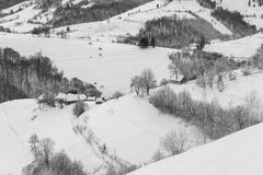 Transylvanian Winter Mountain Landscape. Winter snowy landscape above a village, in Carpathian Mountains at Bran - Moeciu, Holbav, Romania Stock Photos