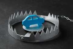 Trap with bait car. The risk of buying bad car. Car insurance. Black background. Trap with bait car. The risk of buying bad car. Car insurance. Black background stock images