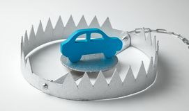 Trap with bait car. The risk of buying bad car. Car insurance. Gray background. Trap with bait car. The risk of buying bad car. Car insurance. Gray background royalty free stock images