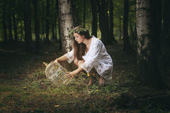 Trap for fairies. Beautiful girl staring at her fairies trap . Fantasy concept Stock Images