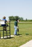 Trap shooting. Shooting clay pigeons at a trap shoot range Royalty Free Stock Photo