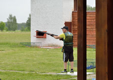 Trap shooting. Kyiv, Ukraine - May 24 2014: A man practises at the clay pigeon shooting Royalty Free Stock Photography