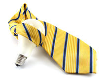 Traped idea in a tie. Traped light bulb in a tie Royalty Free Stock Photo