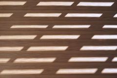 Trapezoid light on wood board Stock Images