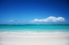 Trapical beach and fluffy clouds Royalty Free Stock Photo
