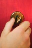 Trappe rouge avec la clé Photographie stock