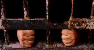 Trapped behind the bars Stock Photography