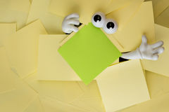 Trapped beneath paper work Royalty Free Stock Image