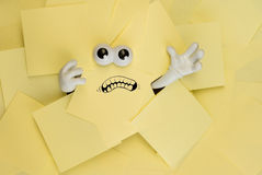 Trapped beneath paper work Royalty Free Stock Photo