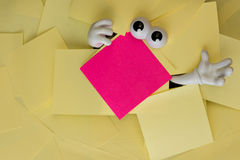 Trapped beneath paper work Royalty Free Stock Photography
