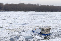 Trapped boat into the frozen Danube river Royalty Free Stock Photography