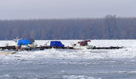 Trapped boats into the frozen Danube river Stock Photos