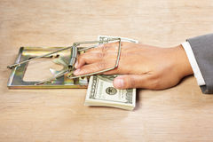 Trapped when catching money Stock Images