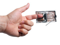 Trapped finger. Forefinger caught with a mousetrap on a white background Stock Photos