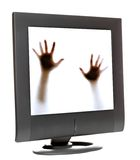 Trapped inside a computer monitor. Person trying to escape from inside a computer monitor stock images