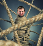 Trapped man. Businessman trapped in rope web Royalty Free Stock Photo