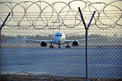 Boeing plane. A Boeing plane behind the Lublinek airport fence in Lodz, Poland stock images