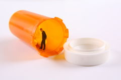 Trapped in a prescription bottle Royalty Free Stock Images
