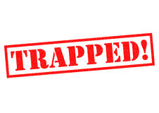 TRAPPED!. Red Rubber Stamp over a white background Stock Images