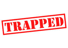 TRAPPED. Red Rubber Stamp over a white background Stock Image