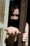 Trapped Woman. A woman trapped in a prison jail cell with a mouth cover Royalty Free Stock Images