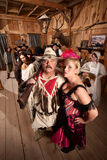 Trapper and Showgirl in Saloon Stock Images