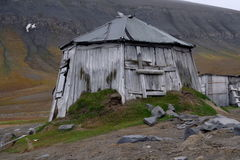 Trappers hut. An old, isolated wooden trappers hut on the barren lands of Svalbard in the Arctic, northern Norway royalty free stock photo