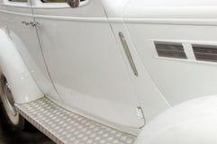 Trappes latérales de véhicule blanc Photos stock