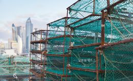 Traps for crabs lay in fishing port of Busan. South Korea. Boxes with green net Stock Photography