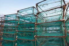 Traps for crabs in fishing port of Busan. Traps for crabs stacked in fishing port of Busan, South Korea. Boxes with green net Royalty Free Stock Image