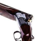 Trasero cargado de la escopeta en blanco Fotos de archivo