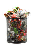 Trash. Bin full of paper trash studio isolated Royalty Free Stock Photography