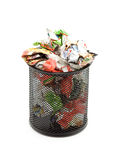 Trash. Bin full of paper trash studio isolated Royalty Free Stock Images