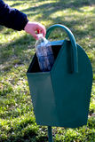 Trash. Throwing to trash a empty bottle Royalty Free Stock Image