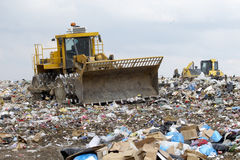 Trash. Overview of refuse collection with bulldozer Royalty Free Stock Photography