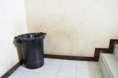 The trash. Area for litter inside a dirty, trash bags and black sphere for sewage Stock Photo