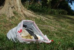 Trash Bag in Nature Stock Photo