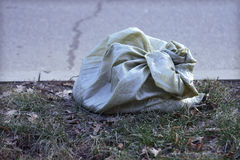 Trash bag on the road. Garbage bag on the road Krasnodar Royalty Free Stock Images