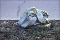 Trash bag on the road. Garbage bag on the road Krasnodar royalty free stock images