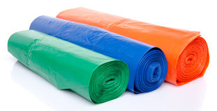 Trash bags in blue, orange and green Royalty Free Stock Photography